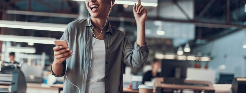 woman listening to the ultimate small business playllist